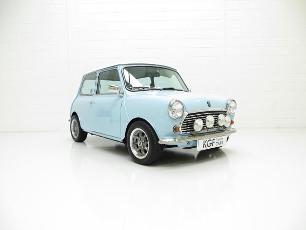 Original Mini in Oxygen Blue, next to a modern mini in ...  Old Blue Mini